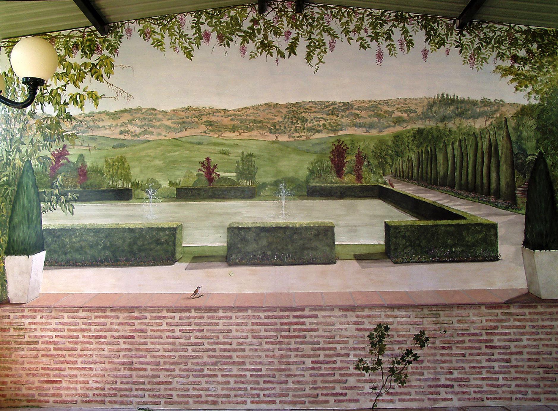 Terraza La Posta Real, falso zócalo en ladrillos y paisaje
